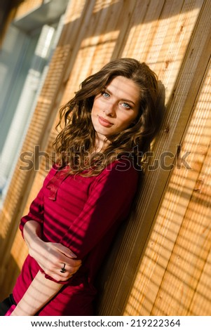 beautiful young woman blue eyes girl with shadow from window blinds - stock photo