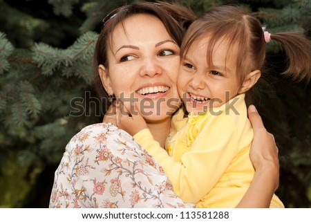 Beautiful young woman brought to walk her little daughter - stock photo