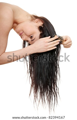 Beautiful young woman brushing hairs, isolated on white