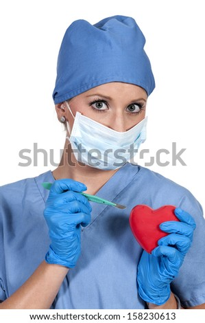 Beautiful young woman cardiology surgeon performing surgery