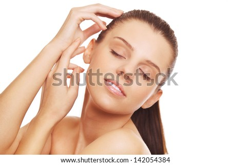 beautiful young woman cares for skin face on white background - stock photo