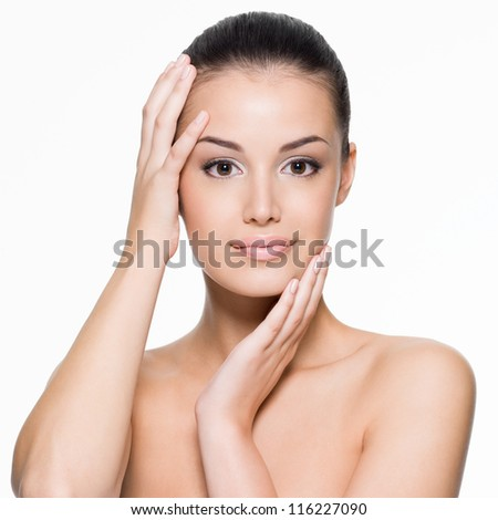 Beautiful young woman cares for the skin face -   isolated on white - stock photo