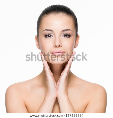 Beautiful young woman cares for the skin face- posing at studio  isolated on white - stock photo
