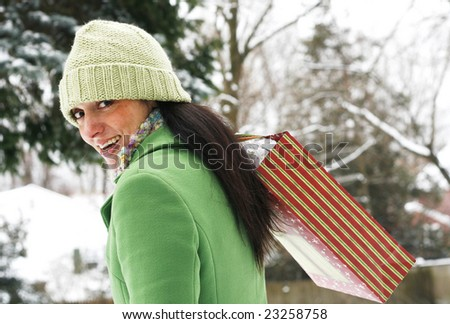beautiful young woman carrying shopping bag - stock photo