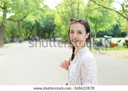 Beautiful young woman Caucasian summer trip to Europe in Vondelpark - stock photo