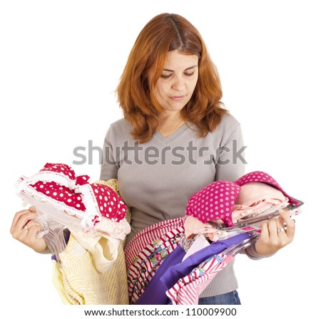 Beautiful young woman choosing clothes. Isolated on white - stock photo