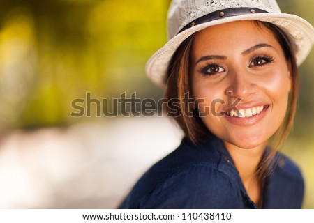 beautiful young woman closeup portrait outdoors - stock photo