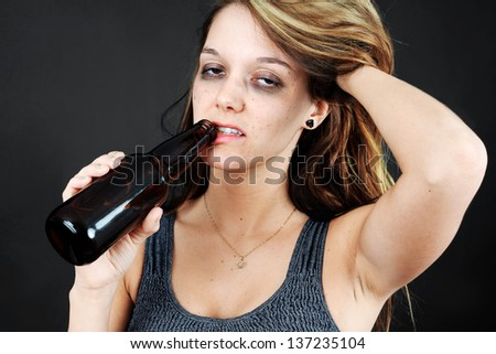 Beautiful young woman completely drunk or alcoholic - stock photo