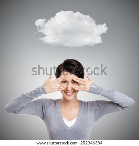 Beautiful young woman covers her eyes with hands, isolated on grey background - stock photo