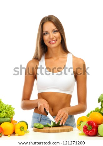 beautiful young woman cutting vegetables, isolated on white