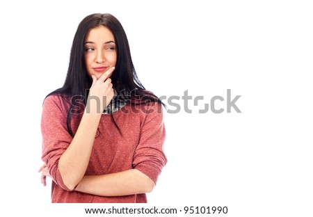 Beautiful young woman daydreaming over white background with finger on chin