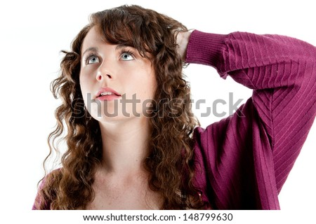 Beautiful young woman deep in thought - stock photo
