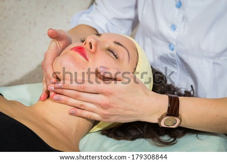 Beautiful young woman doing cosmetic procedures in the spa salon