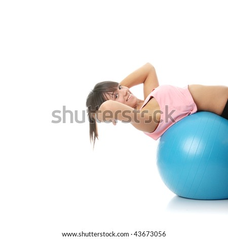 Beautiful young woman doing exercise , isolated