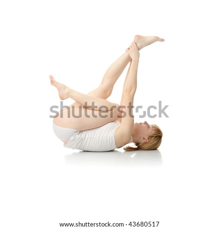 Beautiful young woman doing exercise , isolated - stock photo