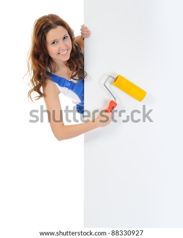 Beautiful young woman doing repairs isolated on white background