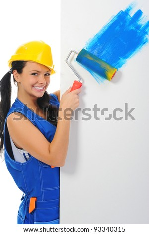 Beautiful young woman doing repairs isolated on white background - stock photo