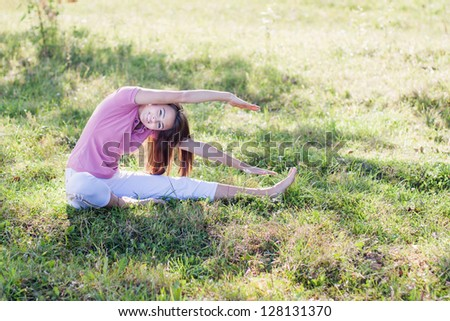 Beautiful young woman doing stretching exercise