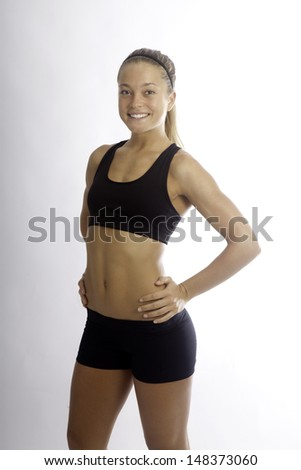 beautiful young woman doing stretching exercises - stock photo