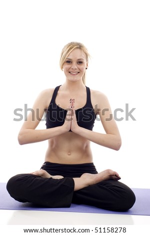 Beautiful young woman doing yoga isolated on white background - stock photo
