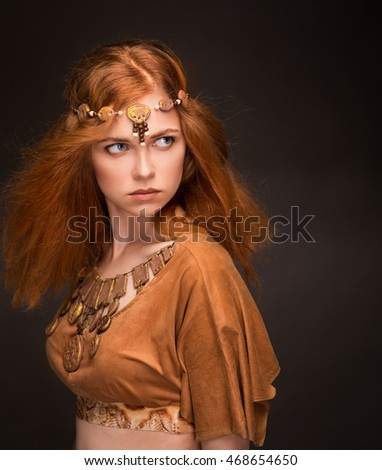Beautiful young woman dressed as Amazons
