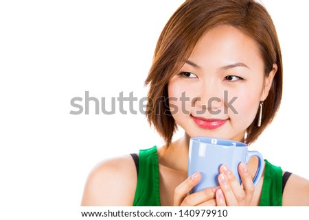 Beautiful young woman drinking  coffee while Looking to the right side. Isolated on white background. - stock photo