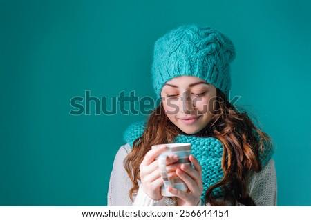 Beautiful young woman drinking tea. - stock photo