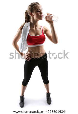 Beautiful young woman drinking water after training / photo set of sporty muscular female brunette girl wearing sports clothes over white background - stock photo