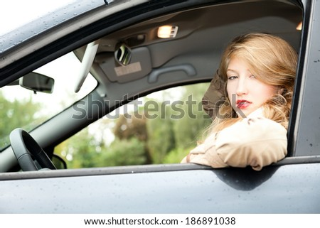 beautiful young woman  driving a car  - stock photo