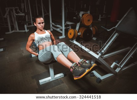 Beautiful young woman during fitness - stock photo