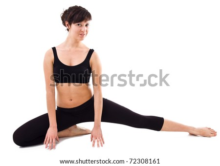 Beautiful young woman during workout with isolated background.