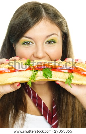 beautiful young woman eating a hamburger isolated against white background - stock photo