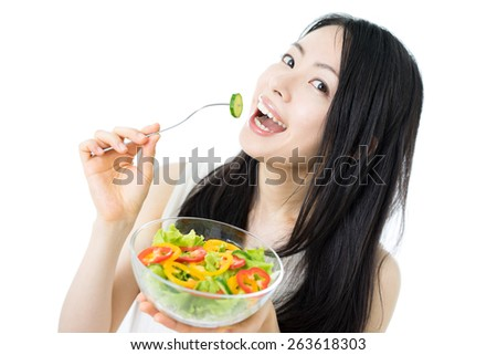 beautiful young woman eating salad, isolated on white background