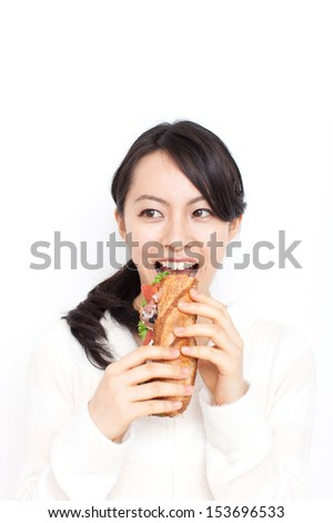 beautiful young woman eating sandwiches