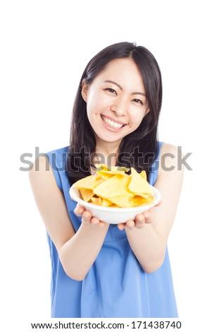 Beautiful young woman eating tortilla chip  - stock photo