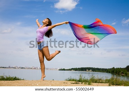 Beautiful young Woman enjoy and jumping on the beach - stock photo