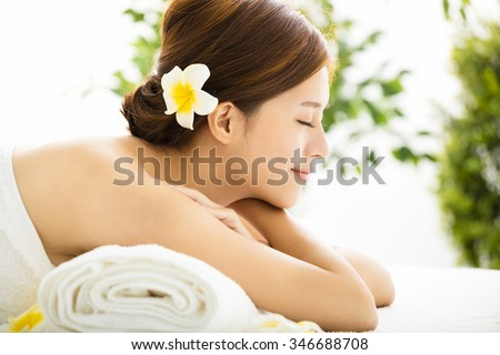 Beautiful young woman enjoy spa salon - stock photo