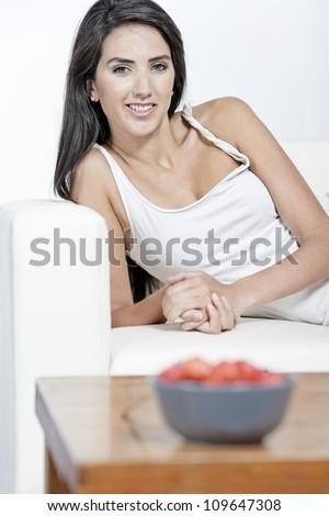 Beautiful young woman enjoying fresh fruit for breakfast at home - stock photo