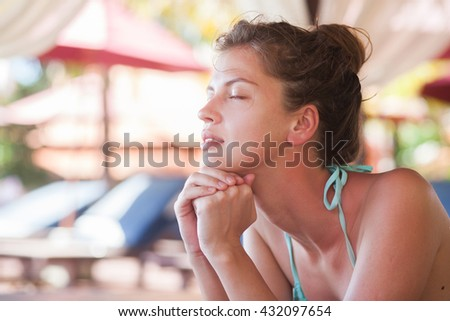 Beautiful young woman enjoying her time in spa - stock photo
