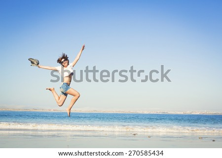 Beautiful young woman enjoying the beach  - stock photo