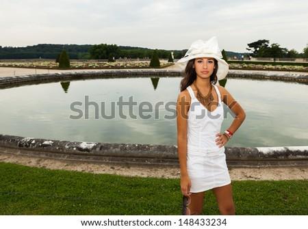 Beautiful young woman enjoying the gardens in Paris. - stock photo