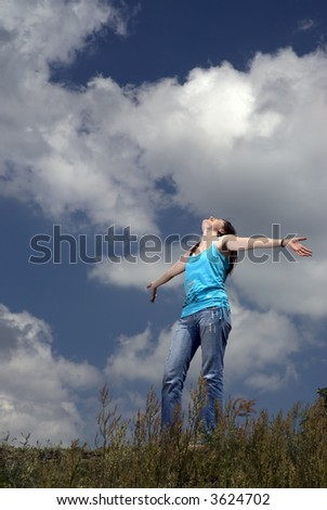 Beautiful young woman enjoys a nice summer day - stock photo