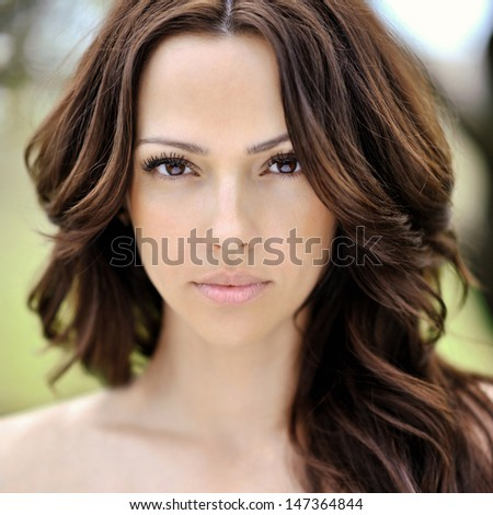 Beautiful young woman face closeup - perfect skin - stock photo