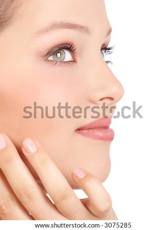 Beautiful young woman face. Isolated over white background