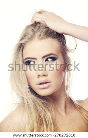 Beautiful young woman face with blond hair isolated on white - stock photo