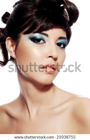 Beautiful young woman face with multicolored make-up and modern hairstyle.