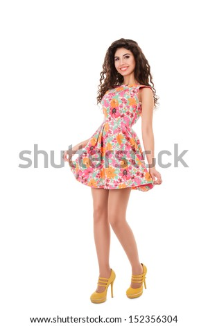 Beautiful young woman full length studio portrait isolated on white background - stock photo