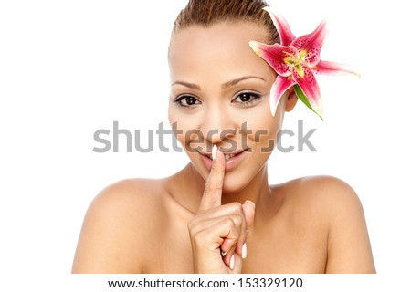 Beautiful young woman gesturing silence