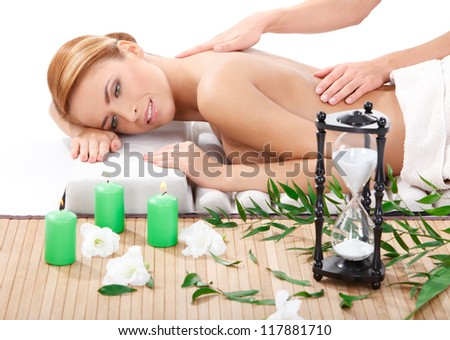 beautiful young woman getting back massage at spa