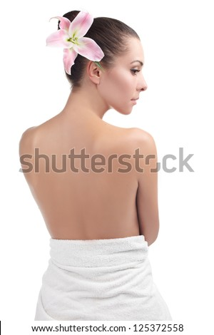 Beautiful young woman getting spa massage. Black amd white